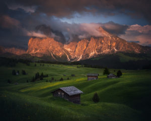 Landscape photography in the Dolomites. Mountain huts at sunset, Alpe Di Siusi.