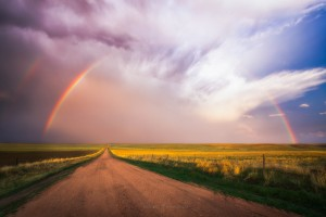 Rainbow over Road at Sunset