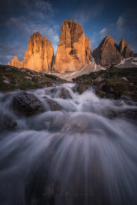 Landscape photography in the Dolomites. Tre Cime long exposure river sunset.